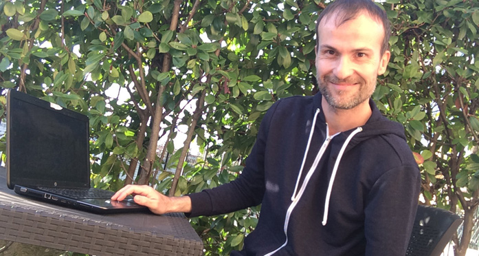 Daniele Carrer in front of his laptop