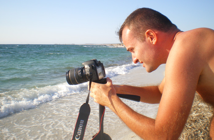 Daniele Carrer shooting stock footage on the beach