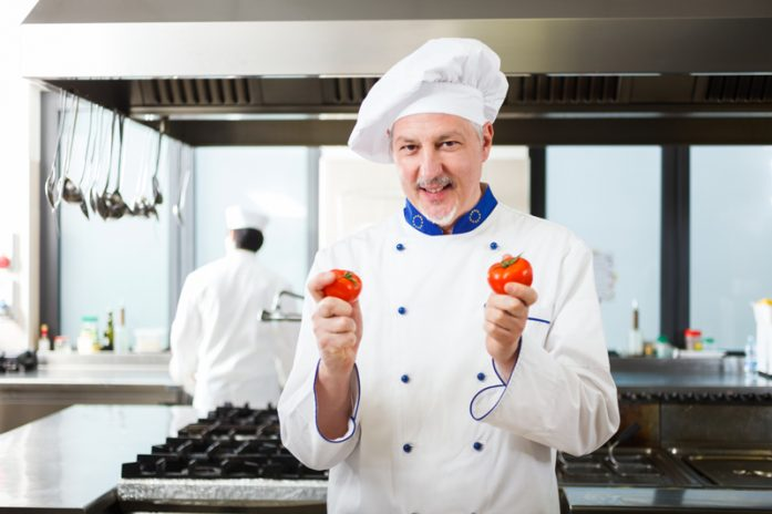 An example of stock image: friendly chef working in his kitchen