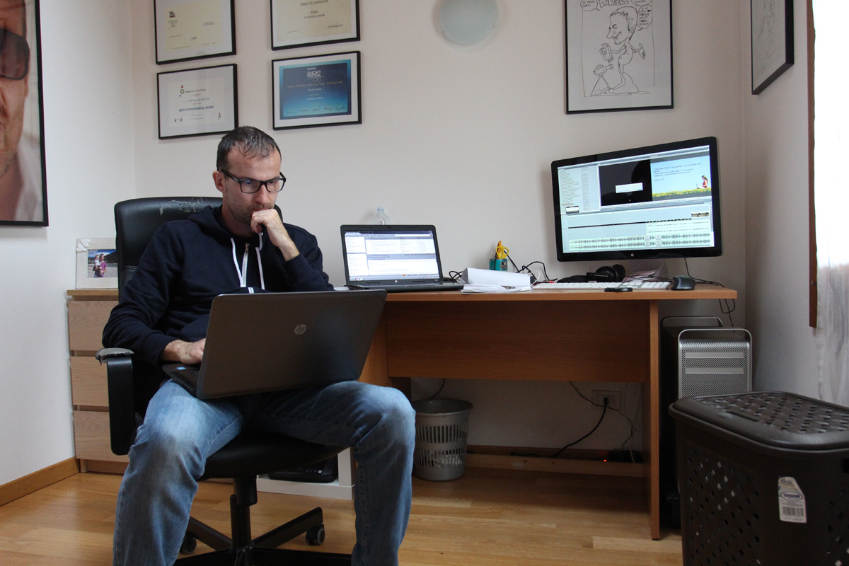 Daniele Carrer in his office working with his laptop