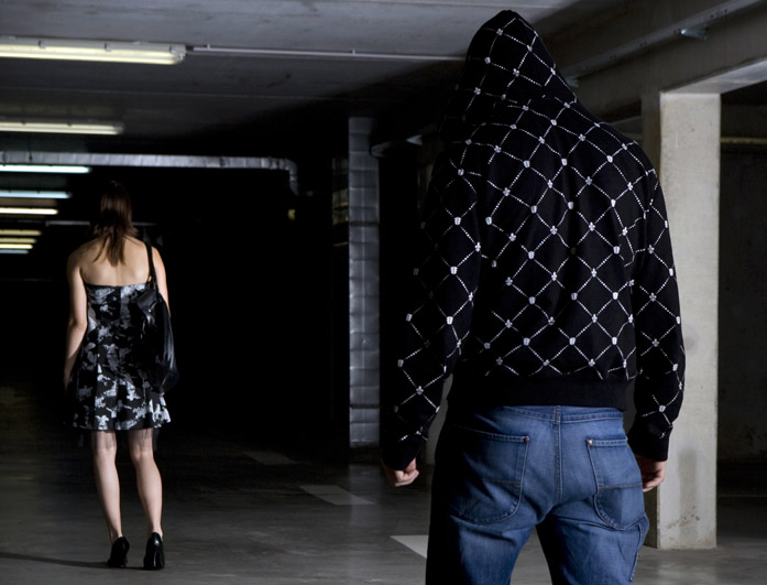 Young woman stalked in an underground garage