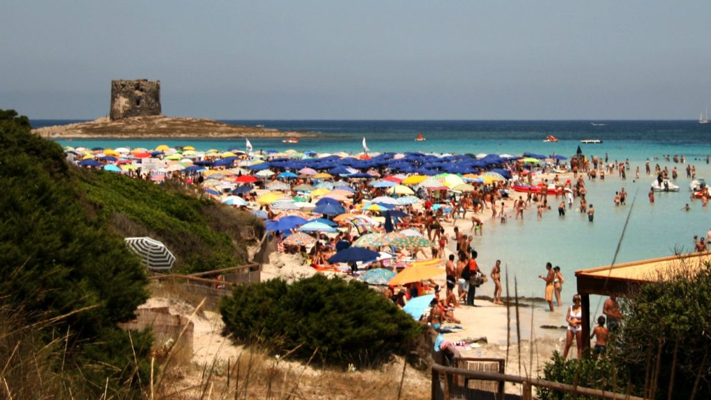 Tourist on the beach of Stintino in Sardinia