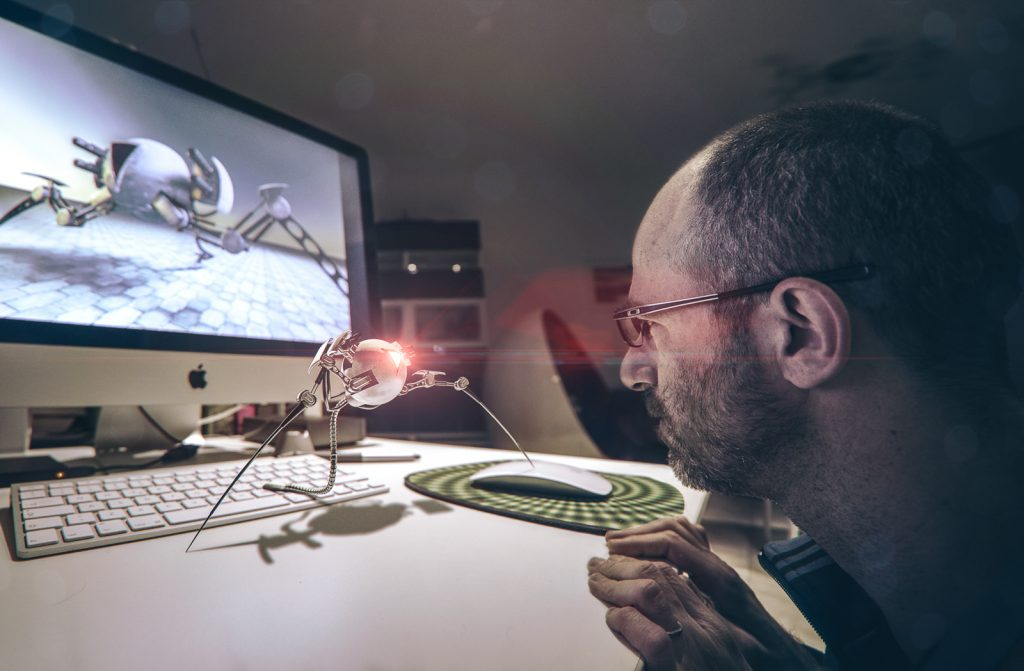 Designer studies his creation on his desktop
