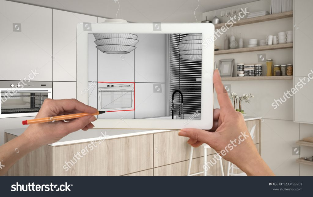Stock image of a Tablet PC framing a kitchen