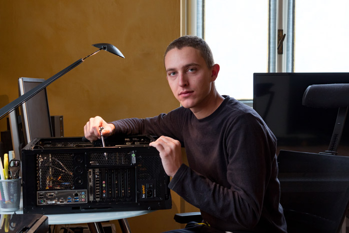The stock footage producer Domenico Fornas in front of his computer