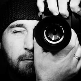 Portrait of photographer Marco Cirone with his camera