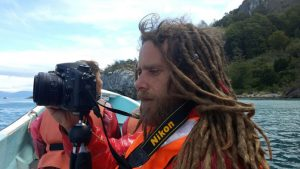Photographer Simone Scalise while taking pictures from a boat in the sea