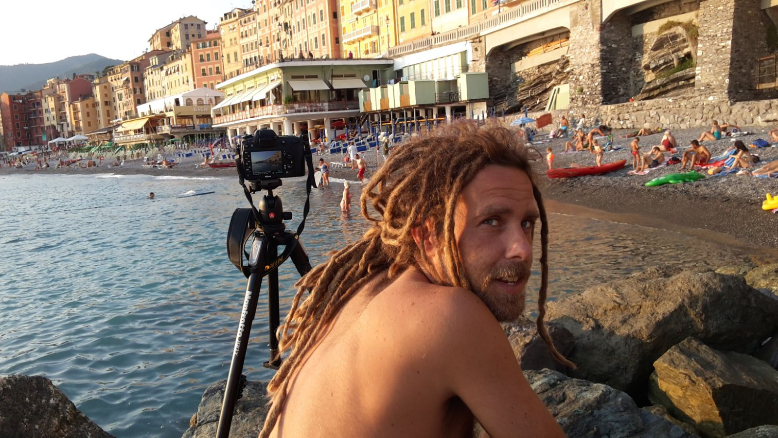 Photographer Simone Scalise while shooting the beach of Genoa