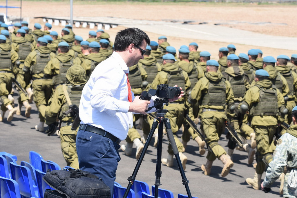 Video maker Ruggero Piccoli while shooting a soliders parade in Astana