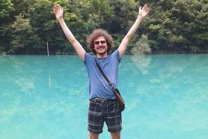 The stock images producer Fabrizio Misson in front of an alpine lake