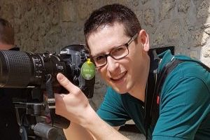 The photographer Marco Lazzarini while shooting with his Nikon